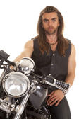 Man leather vest motorcycle close serious — Stock Photo