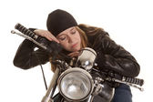 Woman black leather motorcycle lay sleep — Stock Photo