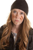 Woman black leather mud on face mad — Stockfoto
