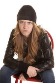 Woman leather sit mad — Stock Photo