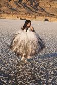 Woman formal run on ice look side — 图库照片