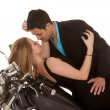 Couple lay on motorcycle faces close — Stock Photo #38550795