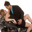 Stock Photo: Couple lay on motorcycle him lean