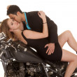Stock Photo: Couple lay on motorcycle kiss neck