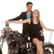Woman sit motorcycle man behind both look — Stock Photo