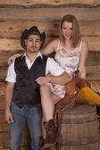 Couple western woman on saddle both look — Stock Photo