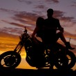 Постер, плакат: Couple on motorcycle her lean back him hold