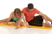 Couple fitness sit and stretch — Stock Photo