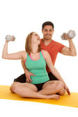 Couple sit flex weights laugh — Stock Photo