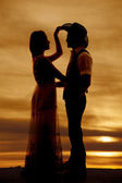 Cowboy couple silhouette her hand his hat — Stock Photo