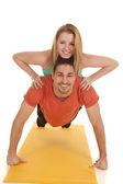 Man pushup woman on back smiles — Stock Photo