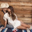 Cowboy and Indian woman sit front ready to kiss — Stock Photo #38623837
