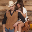 Cowboy and Indian woman sit saddle both look — Stock Photo #38624449
