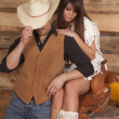 Cowboy and Indian woman sit saddle face hidden — Stock Photo