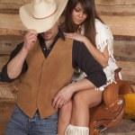 Cowboy and Indian woman sit saddle face hidden — Stock Photo #38624463