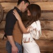 Cowboy and Indian woman white skirt almost kiss — Stock Photo #38624753