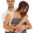 Man behind woman blue dress arms around her — Stock Photo #38625217