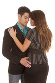 Business couple embrace her back — Stock Photo