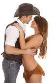 Cowboy and indian woman embrace almost kiss — Stock Photo