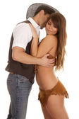 Cowboy and Indian woman embrace kiss neck — Stockfoto