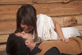 Cowboy and Indian woman laying almost kissing — Stock Photo