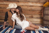 Cowboy and Indian woman sit front ready to kiss — Stock Photo