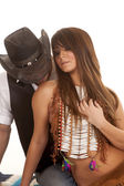 Cowboy and Indian woman sit kiss shoulder — Stock Photo