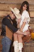 Cowboy and Indian woman sit saddle tip hat — Stock Photo