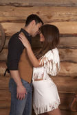 Cowboy and Indian woman white skirt almost kiss — Stock Photo