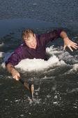 Man in ice hole axe intense — Stock Photo