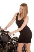 Woman black dress and motorcycle handlebars look down — Stock Photo