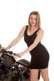 Woman black dress and motorcycle handlebars looking — Stock Photo