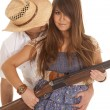 Cowboy behind woman with gun behind hat — Stock Photo
