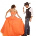 Cowboy woman orange dress dance hold dress — Stock Photo #38933545