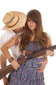 Cowboy behind woman with gun behind hat — Stock Photo