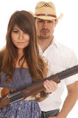 Cowboy behind woman with gun serious — Stock Photo