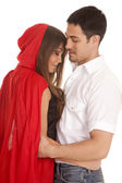 Man and red riding hood arms around each other — Stock Photo
