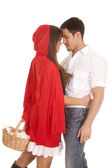 Man and red riding hood basket heads touch — Stock Photo