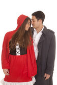 Man and red riding hood gazing — Stock Photo