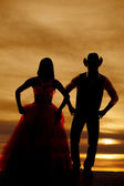 Silhouette couple stand hands hips — Stock Photo