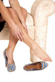Woman black skirt rub leg one shoe off — Stock Photo