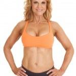 Mature woman orange bra stand hands hips — Stock Photo #39566795