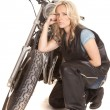Stock Photo: Womin leather kneel by motorcycle serious