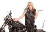 Woman leather sit motorcycle backwards shrug — Stock Photo