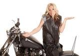 Woman leather sit motorcycle backwards shrug — Stock Photo