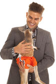 Man in sut hold kangaroo in shorts — Stock Photo
