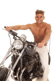 Man no shirt on motorcycle big smile — Stock Photo