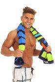 Man swimsuit with towel around neck — Stockfoto