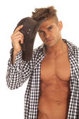 Man with open shirt hold hat by head — Stock Photo