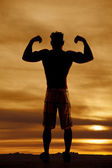 Silhouette wet man muscles flex both arms up — Stock Photo